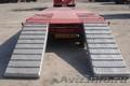 Аренда низкорамного трала для перевозки экскаваторов бульдозеров бытовок вагончи